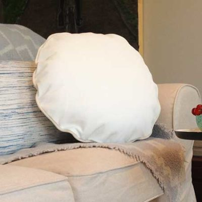 small round pillow in recycle leather and cotton white